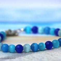 Bracelet bleu en perles rondes oeil de chat