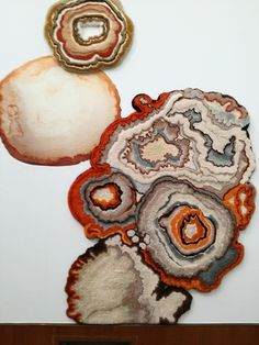 Decay becomes her archival resource for design....tufted rugs, wallpaper, other mediums.