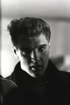 "This shot of the King of Rock Roll was taken in Memphis, Tennessee, on March 15, 1960: Elvis had just returned to the U.S. from his stint in Germany with the army, which clearly had not done permanent damage to his amazing hair. A few days later, Elvis would go into a Memphis studio and cut his first post-army single, the number one hit ""Stuck On You."""