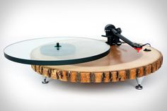 You don't need to be rocking a rustic look in your home for the Audiowood Barky Turntable to fit in with your decor — but it surely wouldn't hurt. This precision piece of equipment is made from a Rega parts kit, featuring a glass platter, a RB303 arm, a Rega Bias cartridge, and a solid ash platform that's finished with polyurethane, wax, and boasts adjustable spike feet. A decent vinyl collection for it to play? That's up to you.