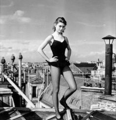 Brigitte Bardot on the roofs of Paris, 1951. Photographed by Walter Carone.