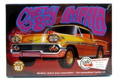 1958 Chevy Impala car model kit by AMT in 1/25 scale. Opening doors Detailed rear suspension Custom steering wheel 409 cu. in. engine Build stock, custom or drag Molded in Gold Brand new in sealed box
