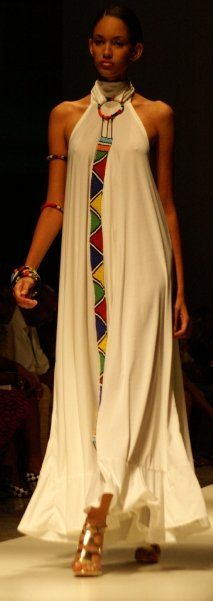 Caribbean fashion week - Halter long white maxi dress with bold geometric print and ethnic themed jewelry worn with metallic gold stiletto sandals. African Print Fashion, Ethnic Fashion, Fashion Prints, Boho Fashion, Fashion Show, Fashion Design, African Attire, African Dress, Kaftan