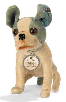 A STEIFF SEATED BULLY, (3410), blue and white velvet, brown and black glass eyes, black stitching, swivel head, remains of horsehair collar, white chest tag with metal rim and FF button, circa 1928 --3¾in. (9.5cm.) high (some discolouration)