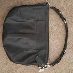 Coach Black Leather Purse Black leather handbag.. used but is in good condition.  No marks on leather and interior has a little fading in one spot. Willing to hear offers. Coach Bags Shoulder Bags