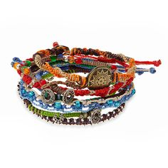 A set of seven handmade bracelets, each given unique charms, beads and knotwork to suggest the history of the earth.