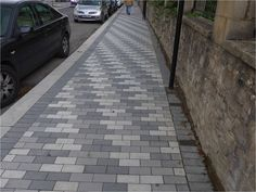 This paving pattern on a pavement in Bath is laid in different shades of grey brick paviors. The pattern is quite disturbing and could be confusing to people with visual impairments. The edge of the pavement could also be hard to distinguish. Block Paving Patterns, Grey Block Paving, Block Paving Patio, Driveway Paving, Driveway Design, Pattern Blocks, Pavement Design, Grey Brick, Distinguish Between