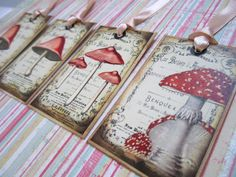 """Beautiful wild mushroom handmade vintage inspired tags that you can use as a favor gift tag, thank you note, bookmark, or embellish your scrapbook. This is a listing for 4 toadstool tags shown.   Tags measure about 3.25"""" x 2"""".  I love custom orders. Please contact me and let us create a speci..."""