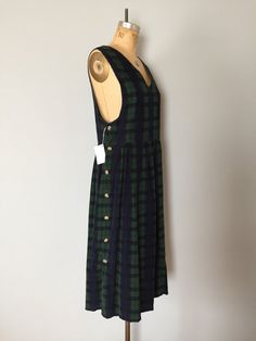 Vintage cotton micro corduroy pinafore dress. One side buttoned down maxi dress in green tartan print.  Jenny Buchanan circa 1990s 100% cotton  fits like small, medium  measurements:  15 shoulders 36 bust 32 waist 46 length  excellent condition