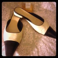 "Vintage Chanel ""Authentic"" Two-Toned Mules These are authentic Vintage Chanel soft leather mules made in Italy. They are black and cream in very good condition and comfortable with that lower heel. Lots of life left to look great. Smoke free. Size 38 1/2. CHANEL Shoes Mules & Clogs"