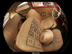 Burlap Bags for seat covers....Brilliant....but I bet very itchy!