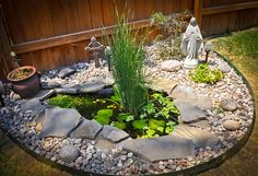 If i lived in a house with a yard of my own, I would love a little spot with a tiny pond.