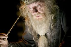 Dumbledore uses the Elder Wand to extract a memory
