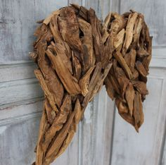 Adorn your house with these lovely natural wooden angel wings made from fir root (they smell heavenly - a bit like cedar).  They have natural twine loops for ha