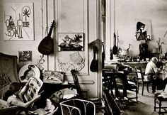 """Picasso painting ceramics in the dining room studio,  while Jacqueline is chillin' on the sofa  in the living room.  """"La Californie""""  Cannes, France  1956"""