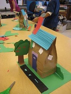 Paper Lunch Bag houses are a great and cheap craft for a rainy day and a great backdrop for cars and dolls.