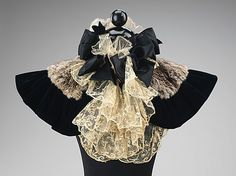 Capelet | United States, 1895-1899 | Materials: fur, silk | This youthful cape evokes the highly feminine fashions of the time. Although it is far more decorative than protective, its bows, fur trim and lace would flatter the wearer's face and enhance the beauty of her overall ensemble | The Metropolitan Museum of Art, New York