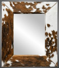 DIY cowhide mirror Cowhide and a good DIY project are two of my favorite things, and these 5 cowhide DIYs are a nice way to bring that all together. Cowhide Decor, Cowhide Furniture, Western Furniture, Rustic Furniture, Cabin Furniture, Furniture Ideas, Furniture Design, Diy Rustic Decor, Rustic Farmhouse Decor