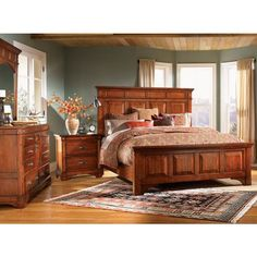 Infuse your decor with a dose of elegant country charm when you add this six-piece bedroom set to your master bedroom suite. Crafted from mahogany wood with a warm brown distressed finish, this set cr