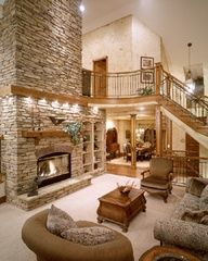 big open room with an open staircase and a fabulous fireplace