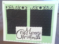 J: Xmas card with embossing and punched border details.