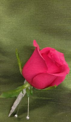 Hot pink rose with gray stem wrap for a pink Ombre' wedding. Boutonniere by Seasonal Celebrations. http://www.seasonalcelebrations.com