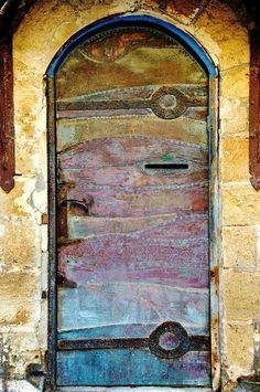 Gorgeous old rustic door with muted descending panels of brown, pale reds! magenta and blue