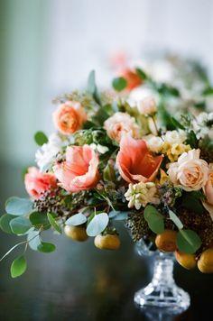 Gorgeous centerpiece with peach amaryllis