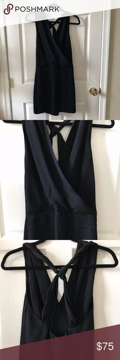 """Banana Republic Criss-Cross Back LBD - 580 NWT Size 2 Banana Republic Criss-Cross Back Little Black Dress.  Perfect dress for a wedding, cocktail party, special event, or a special date night!  Dress features a v neckline and crisis-crossing straps in the back.  Measures 16"""" armpit to armpit, 15"""" across the waist, and 34.5"""" in length.  Pet and smoke free home.  Offers Welcome. Banana Republic Dresses"""