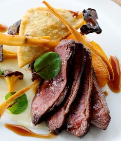Robert Thompson's roast duck recipe brings out a plethora of rich, meaty flavours. Top Tip: Mirepoix is a mix of chopped onion, celery and carrot. You can make the parsnip crisps yourself by very finely slicing the parsnip and deep frying in hot oil until crispy and well-coloured; alternatively you can buy them ready crisped.