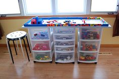 Lego Table - no tutorial but made with a 4' board and lego bases.  Board is not attached to the storage unis but there is non slip fabric underneath to keep in place.  Center part rolls out to make space for chair.  Love it!