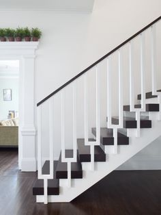 Love the pots over the door frame. Painted Wood Stairs Design, Pictures, Remodel, Decor and Ideas - page 10
