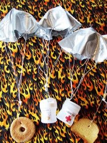 hunger game decoration idea parachutes with food attached and suspended in air