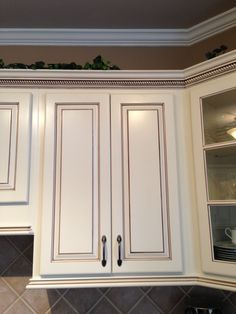 My dream kitchen, at last!; Painted maple cabinets antique white/almond; added light rail at the bottom and rope crown moulding at the top; chocolate brown pen glaze (Faux to Finish); walls are Sherwin Williams Mexican Sand