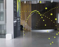 Cause and effect tennis ball installation by Ana Soler