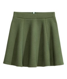 Khaki green/structure. Short circle skirt in jersey. Unlined.