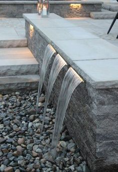 Aquascapes's stainless steel waterfall spillways | kit made to incorporate into any hardscape design