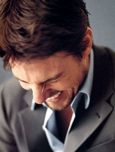 I'm not a Tom Cruise fan but this is a cute photo of him laughing