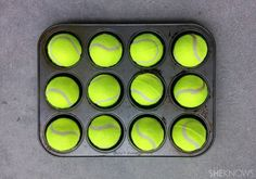You can make your own doggie puzzle with a muffin tin & tennis balls via sheknows