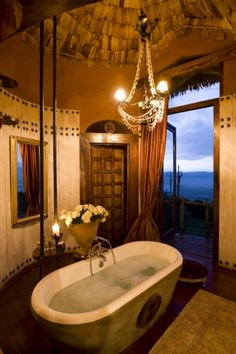 Wedding & Honeymoon photographic safaris and beach resorts on Zanzibar, in Kenya, Tanzania, Mozambique, Seychelles, Maldives, Mauritius and South Africa. image: Ngoorongoro Crater Lodge, Tanzania