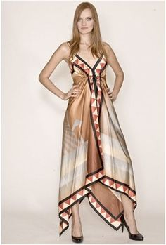 The Rubber Ducky Satin Scarf Graphic Print Dress is a stunning satin scarf dress with the most flattering details.