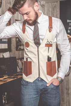 Barber Vest in Canvas Cream Color with Leather Pockets and Straps is part of Barber apron Barber Vest in Canvas Cream Color with leather Pockets and Straps designed by Sweyn Forkbeard and Handm - Barber Shop Interior, Barber Shop Decor, Hair Salon Interior, Andrea Barber, Old School Barber, Barber Tips, Best Barber Shop, Barber Logo, Barber Tattoo