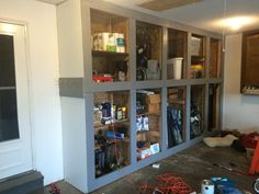Budget ideas and garage organization hacks. Declutter your garage with these sim. Budget ideas and garage organization hacks. Declutter your garage with these sim… Budget ideas a Diy Garage Storage Cabinets, Garage Wall Cabinets, Garage Organization Systems, Diy Cabinets, Wall Cupboards, Organization Hacks, Garage Walls, Garage Doors, Cool Shelves