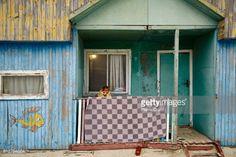 ZATOKA, UKRAINE - AUGUST 12: A woman sits outside her summer... #zatoka: ZATOKA, UKRAINE - AUGUST 12: A woman sits outside her… #zatoka