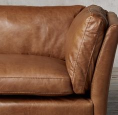 RH's Sorensen Leather Sofa:Danish mid-century modern designers like Ole Wanscher often found their muse in the classical forms of Egypt, Greece and China. We've given his work new expression in our spare and elegant sofa, which has the slightly flared arms and self-possessed style of its forebears.