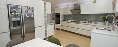 Open plan white gloss German kitchen