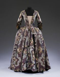 Sack back gown and petticoat, purple silk, brocaded with flowers and lace, French, 1765-17 | | V&A Search the Collections