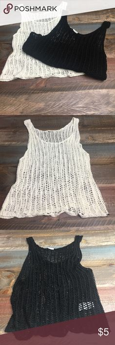 2 croteched tank tops These 2 tanks are just soft & comfortable. One is black & one is a creamy white . Wear over a cami .. Garage Tops Tank Tops