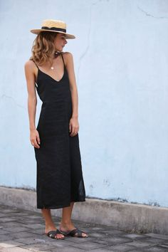 In all the right places. This is a midi length dress with a split on one  side and a tie detail on the back.  •  Adjustable spaghetti straps  • V neck  • Low back  • Relaxed fit  • Partially lined bodice  • 100% Linen  • Cold Hand Wash    **Model wears size XS