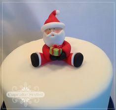 Fondant Santa Claus Cake and Cupcake Topper.